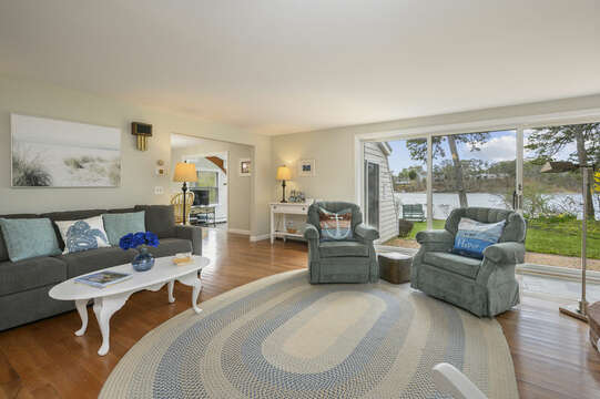 Comfy, family style living room with access to back patio and views of the pond - 35 Vacation Lane Harwich Cape Cod - New England Vacation Rentals