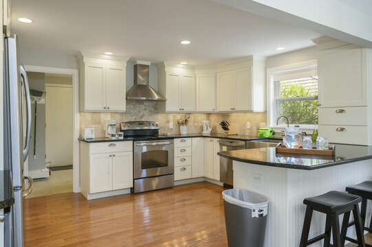 Open kitchen with breakfast bar and 3 stools for additional seating - 35 Vacation Lane Harwich Cape Cod - New England Vacation Rentals