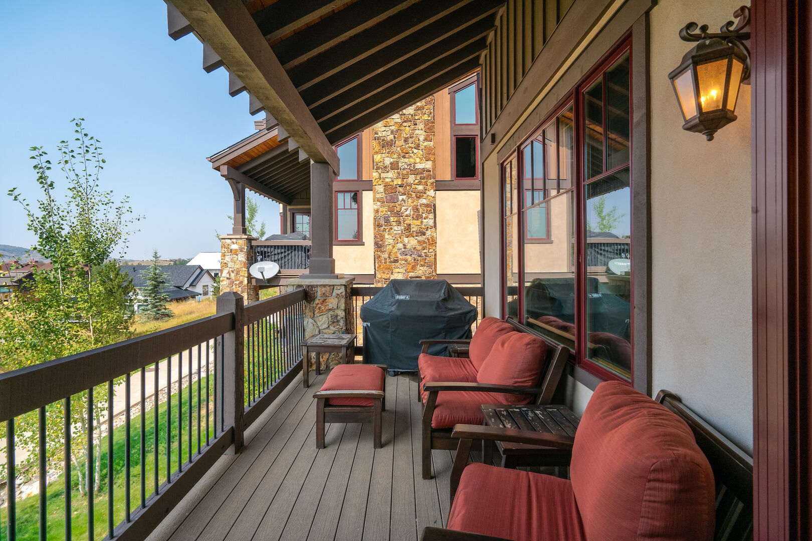 Deck off the dining room with large gas grill