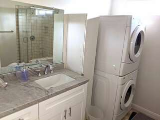 In the shared bathroom for bedrooms 2 and 3 down the hallway you will find the washer and dryer.
