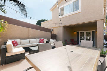 Plenty of seating for everyone to relax and enjoy this comfortable outdoor space.