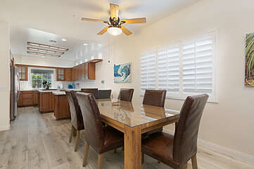 The open plan connects the dining area to the kitchen.