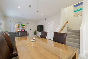 Walk into the kitchen area and you'll find a large dining table with enough seating for 6 people.