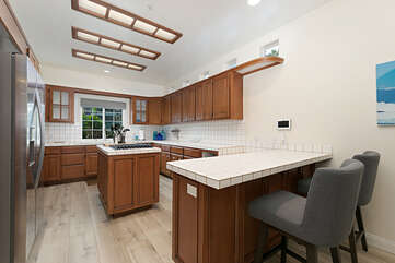 The kitchen offers plenty of counter-space to prepare any meal.