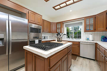 Stainless steel appliances throughout and a large stovetop complete this chef's kitchen.