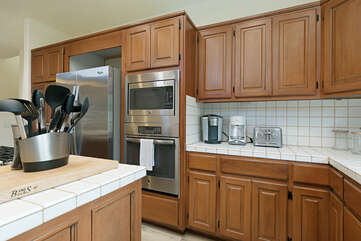 This kitchen features a Keurig and regular coffee maker for your convenience.