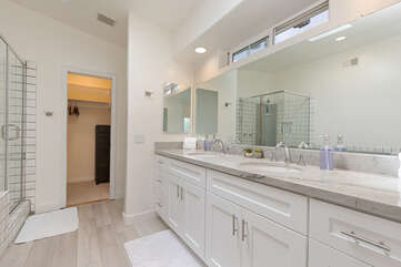 The master bedroom features an ensuite bathroom with newly upgraded quartzite countertops.