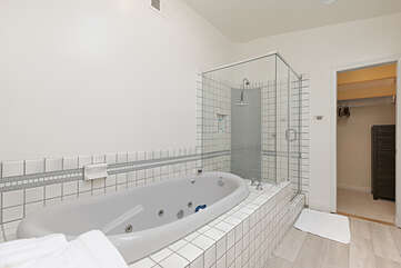 The ensuite in the master bedroom offers a large shower and a soaking tub.