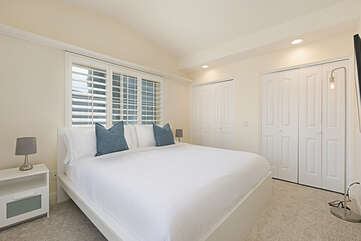 Bedroom two upstairs features a king bed.