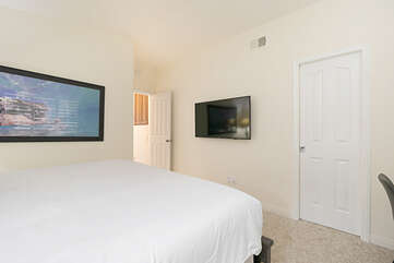 This bedroom also has a large Smart TV with streaming apps and a desk for those who are working.