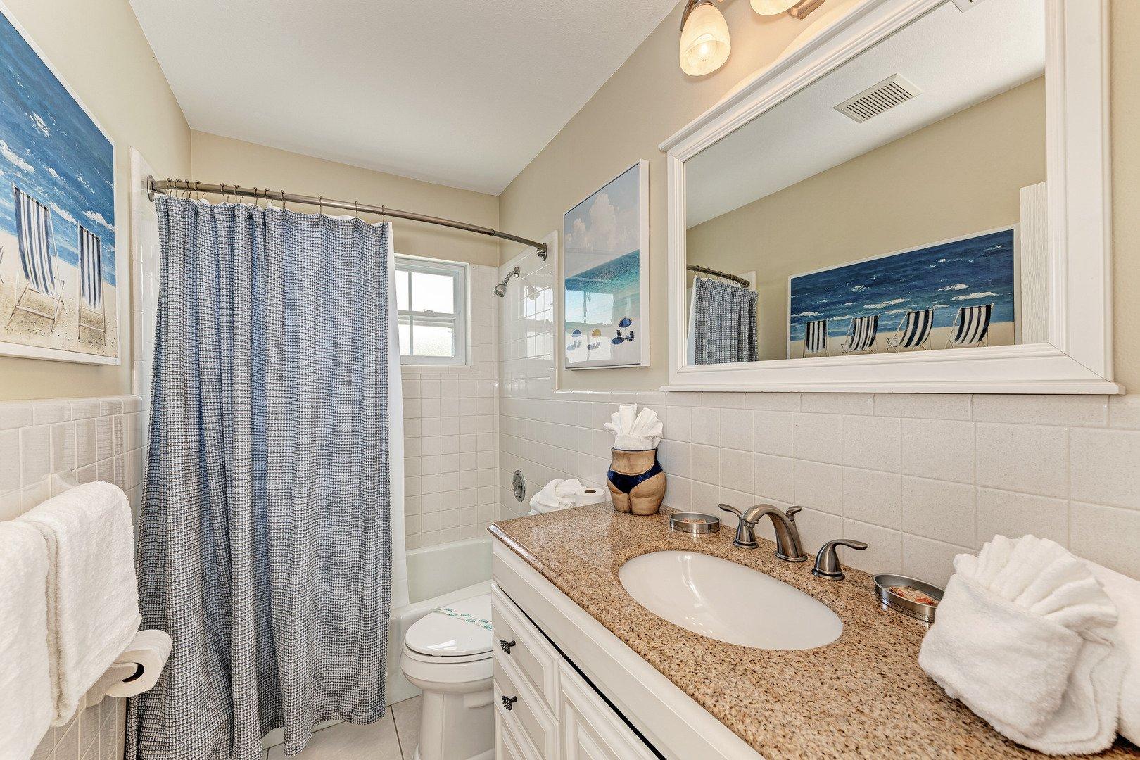 Mermaids & Manatees guest bathroom view from doorway