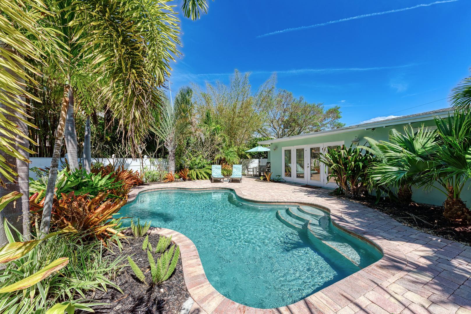 Mermaids & Manatees backyard view of pool