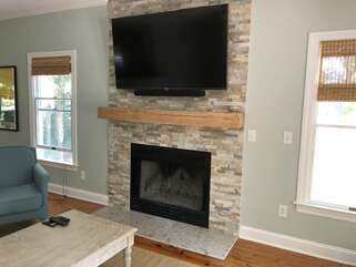 Large television with Yamaha Bluetooth sound bar in family room