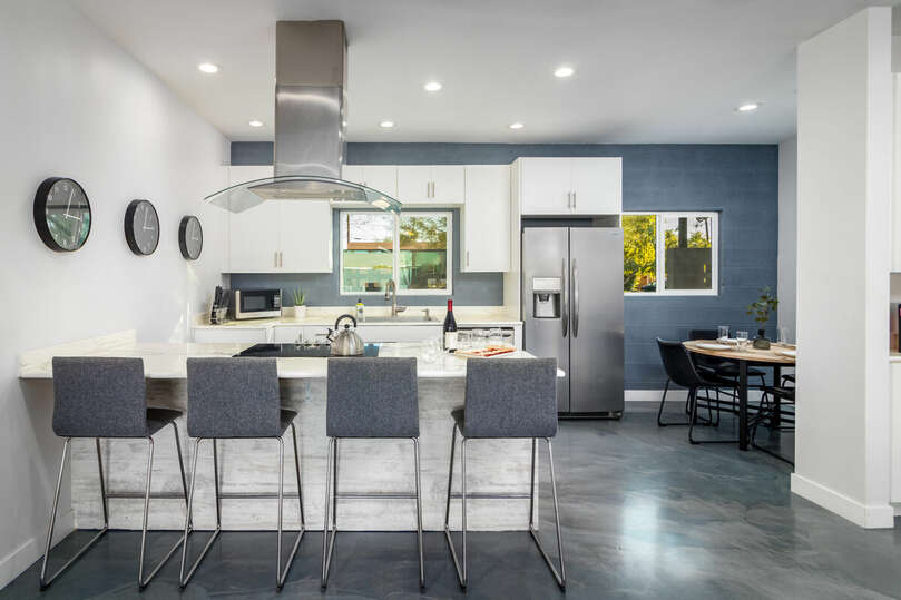 Full kitchen with breakfast bar, nook and all stainless-steel appliances.