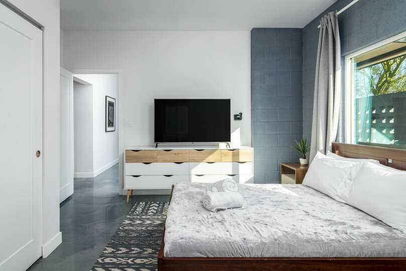 Front bedroom with full bed and TV.