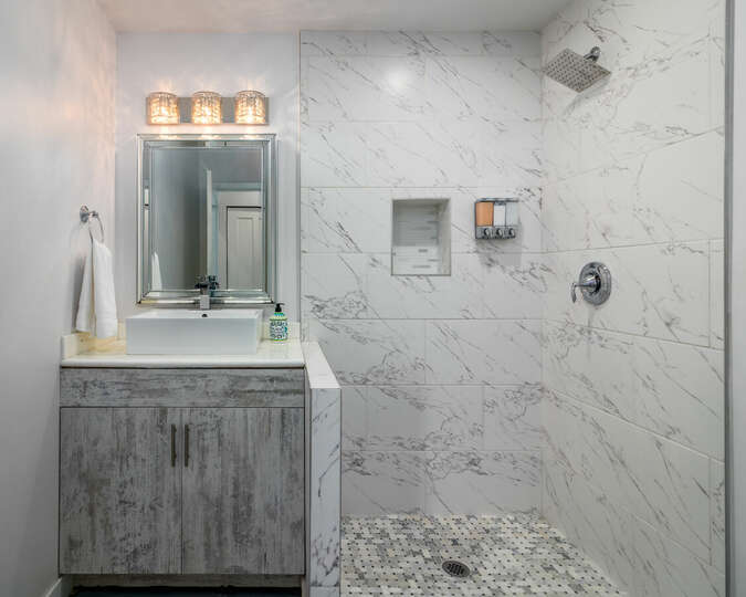 Second bathroom with large shower.