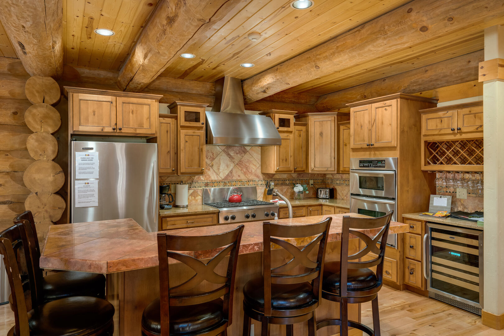 Stainless appliances, wine refrigerator, seating for 5 at the island!
