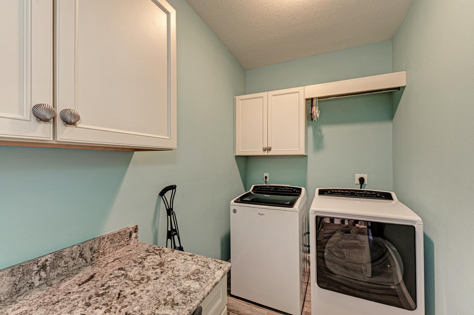 Blue Palm Paradise laundry room