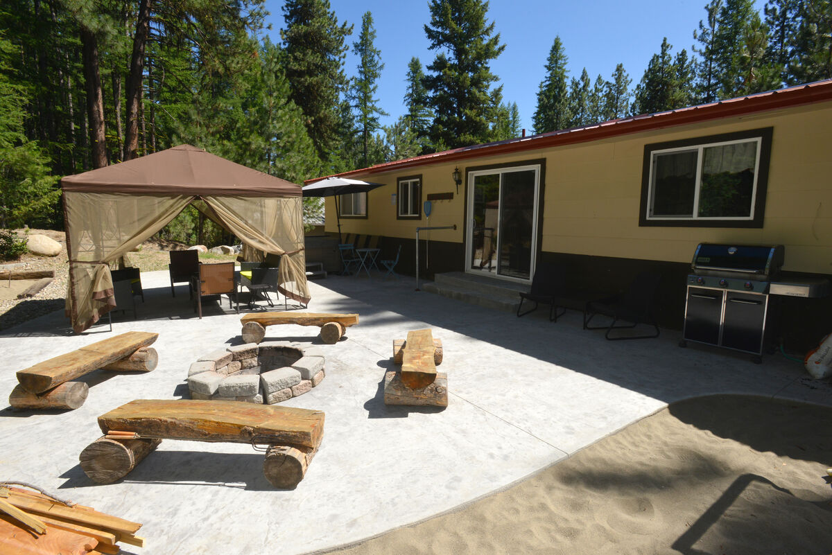 Patio with hot tub, gazebo and lounge area.  Fire pit too.