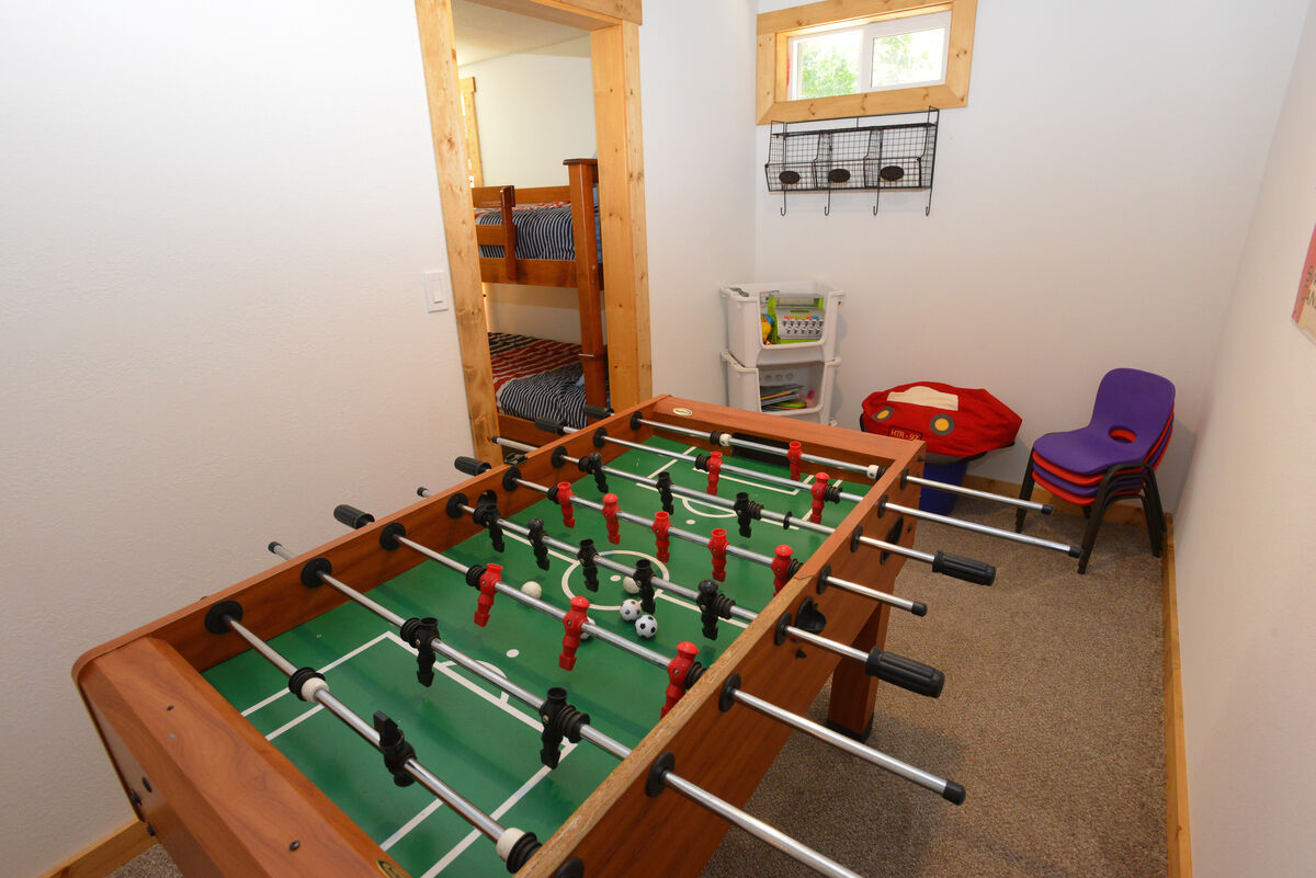 Lower level game room attached to bunk room.