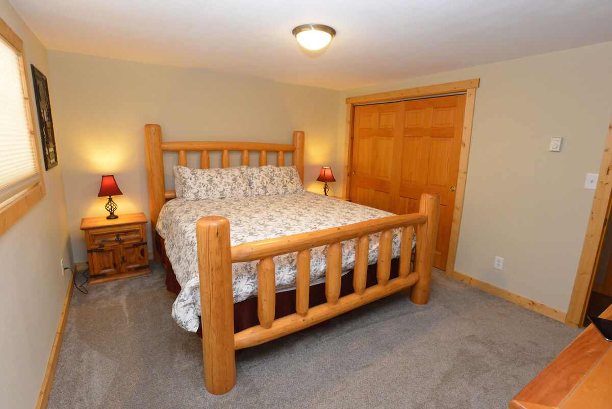 Upper Level master bedroom with attached bath. Spacious closet, tv.