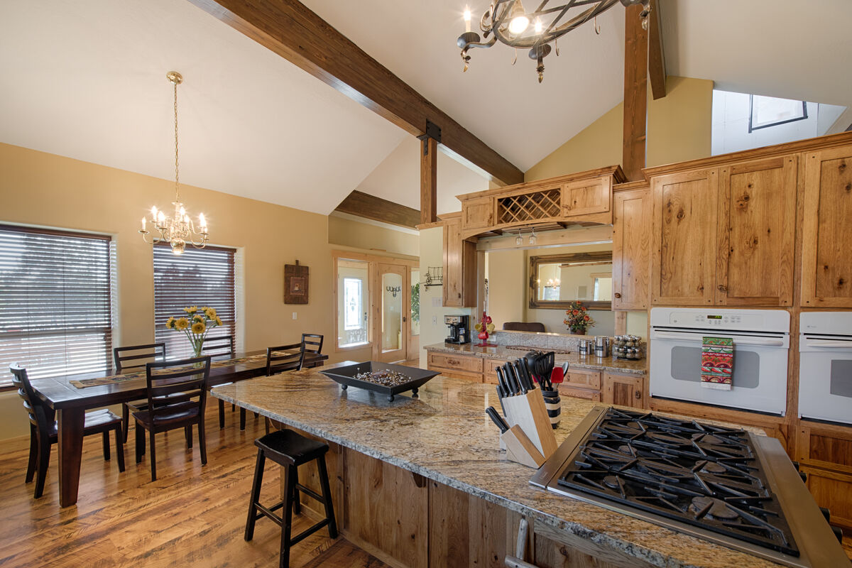 Ranch style kitchen.  Six burner gas range, standard and convection oven.