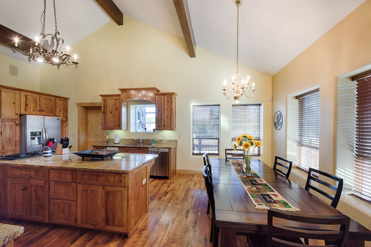 Bright space, dining room table with chair and bench seating.