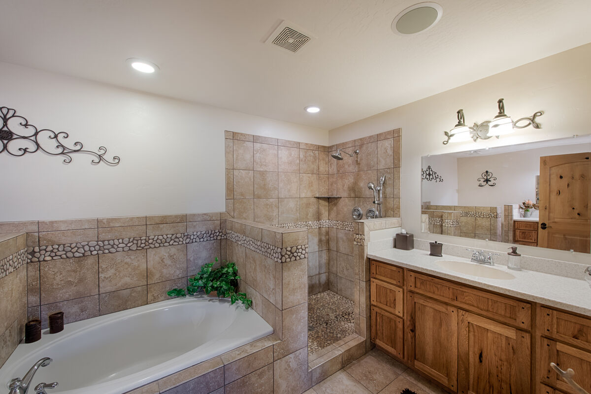 Walk in shower and large, soaking tub.