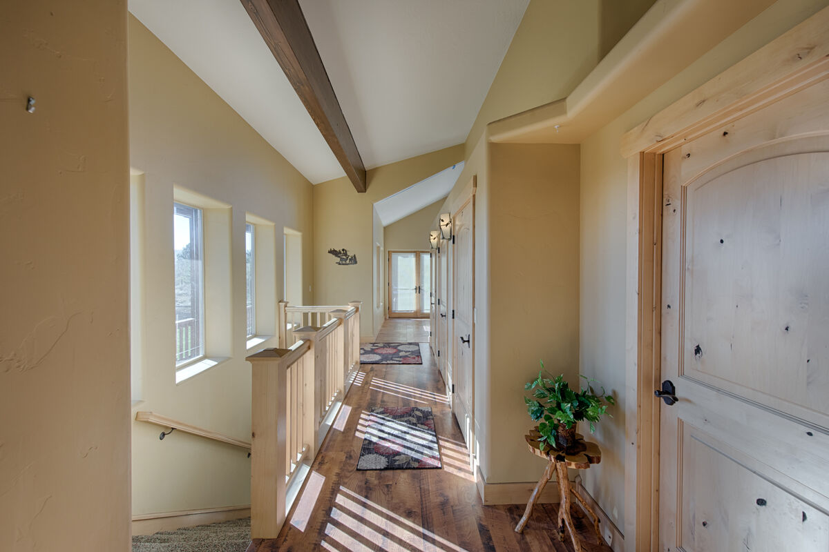 Bright hallway to guest bedrooms and play area.