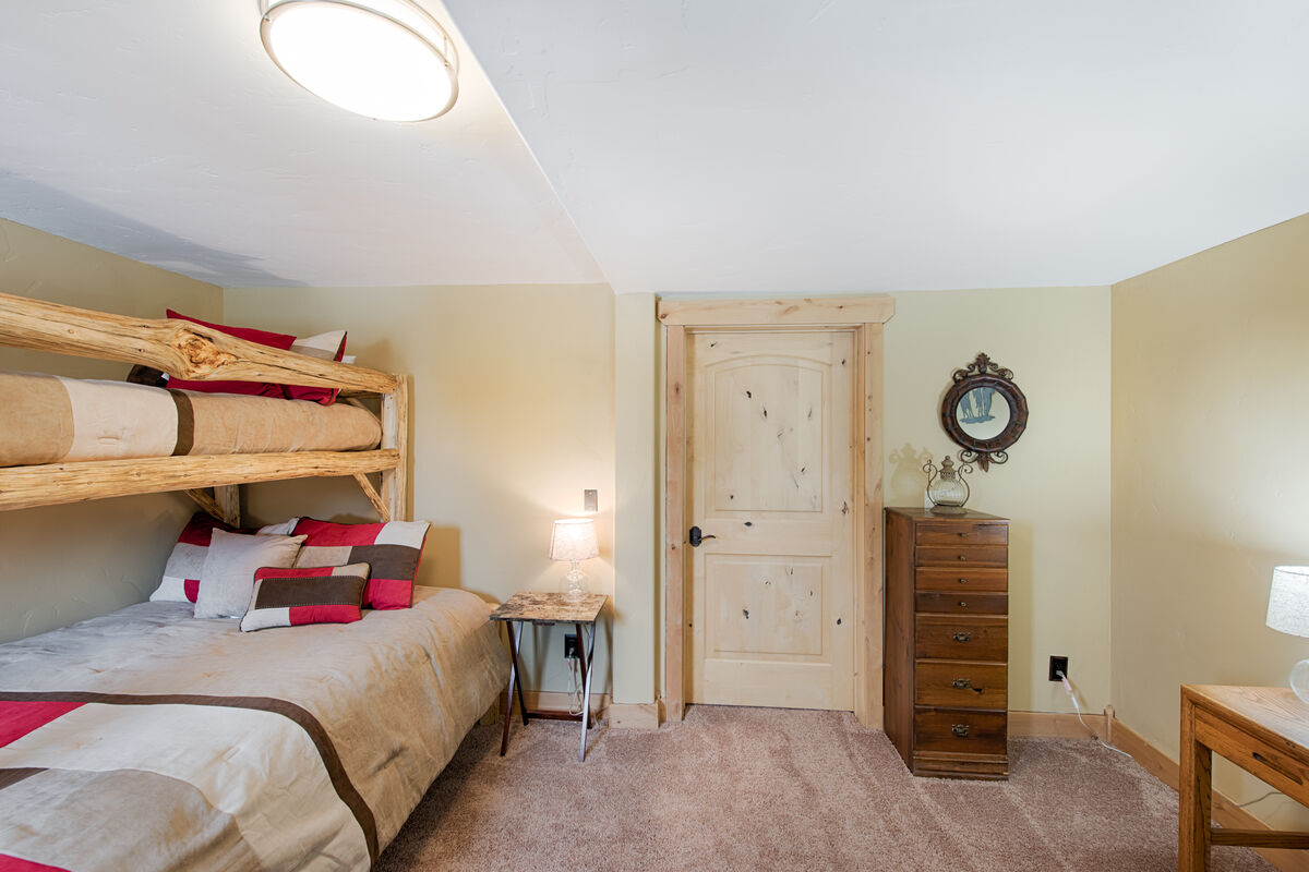 Main level guest room with twin/queen bunk set and twin trundle.