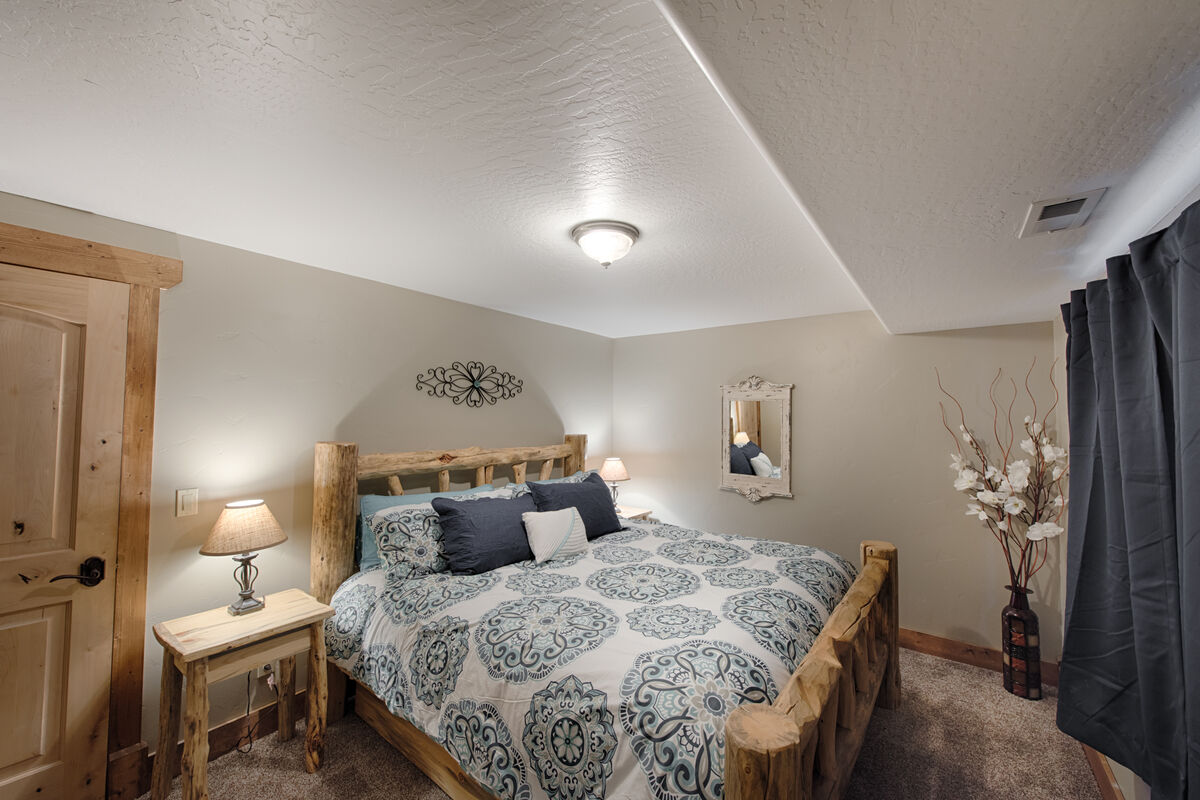 Guest Bedroom with king bed located on lower level.
