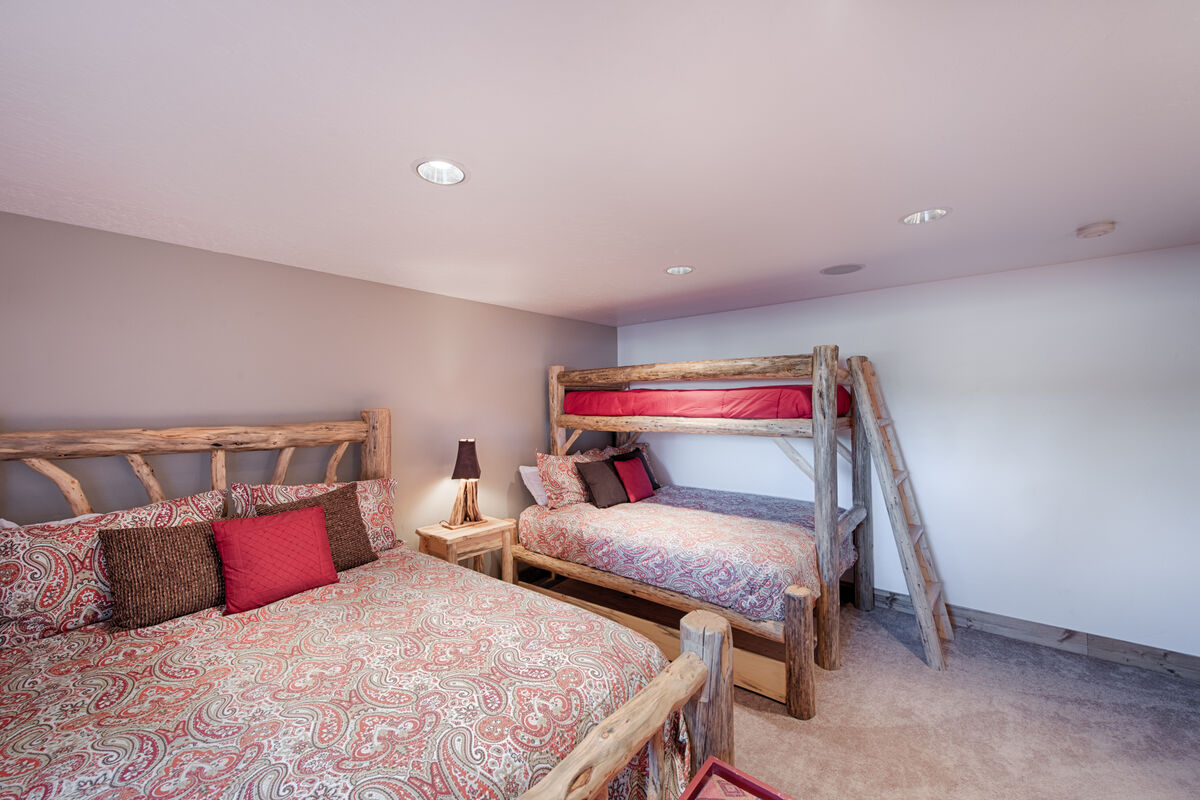Lower level bedroom 3 with Queen bed and adult Twin/Queen bunk set.