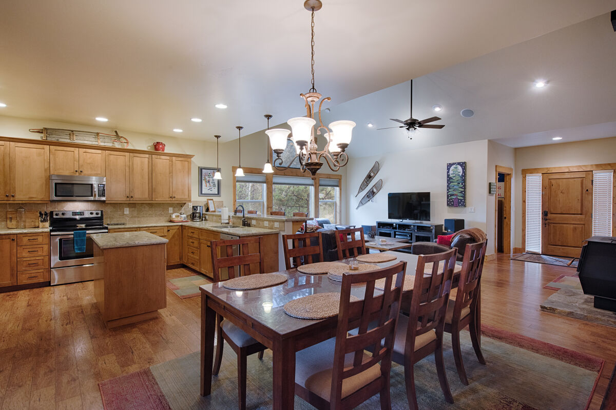 Large, well lit kitchen with stainless appliances.