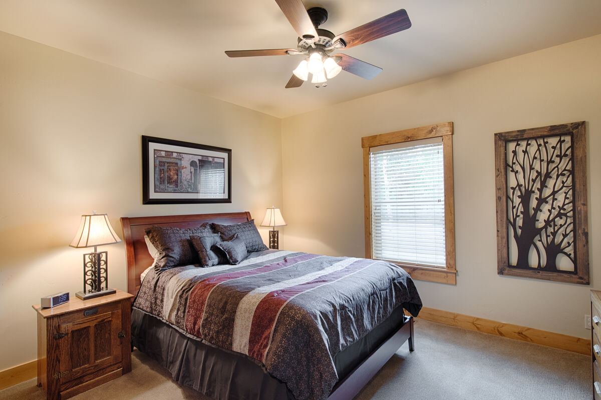 Guest bedroom with queen bed located downstairs.