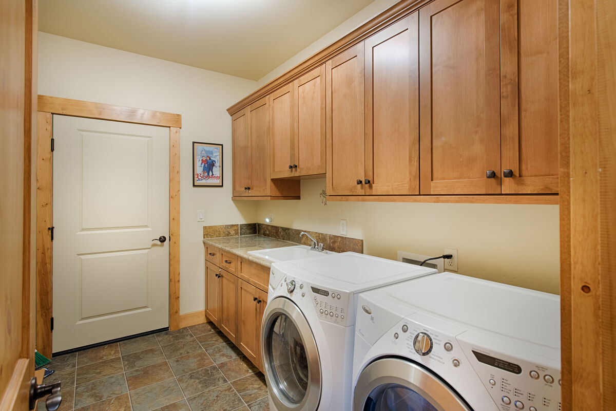 Full size laundry and utility room.