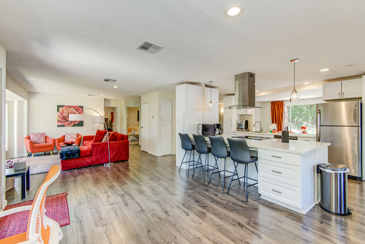 Remodeled Kitchen with Updated Stainless Steel Appliances and Bar Seating for Four