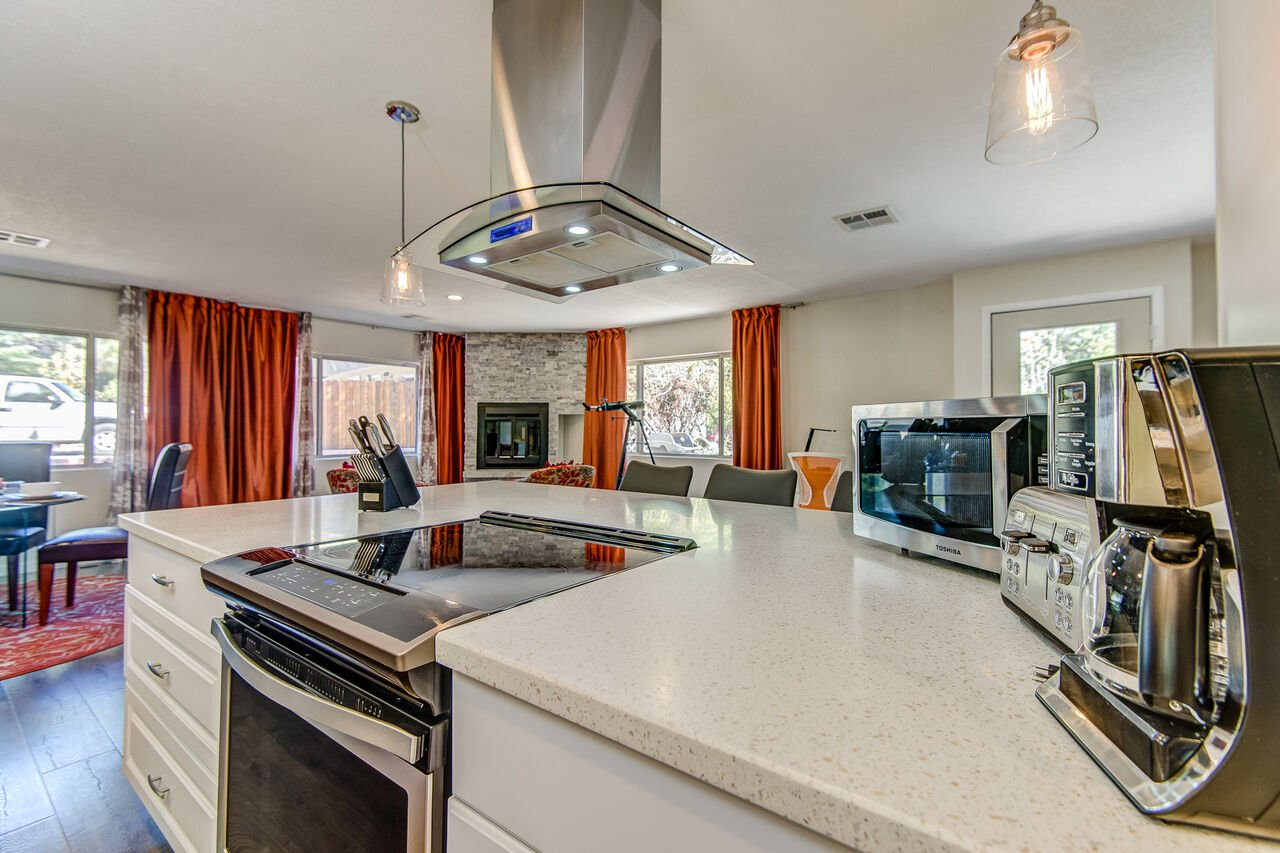 Stone Countertops and an Electric Range in the Kitchen Island
