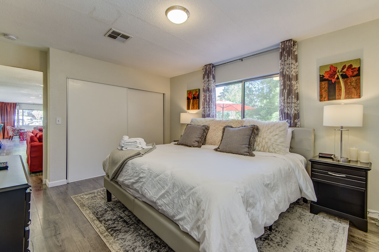 Master Bedroom with a Smart TV and Private Bath