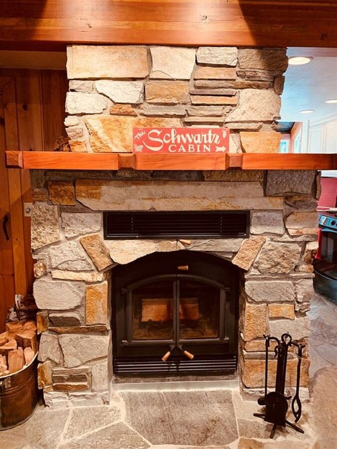 Stone hearth and wood burning fireplace