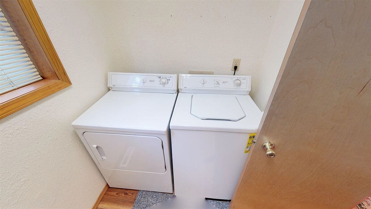 Laundry area off of kitchen.