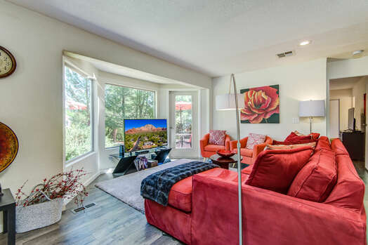 Comfortable Living Room with a Roku TV with Cable and DVD Player, and a Bay Window for Plenty of Natural Light