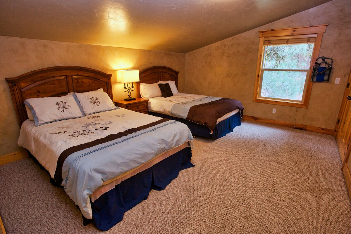 Guest room with queen beds upstairs.