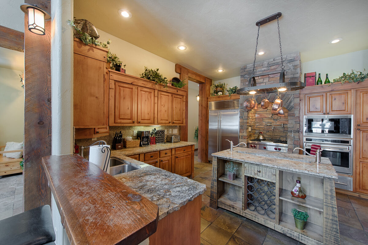 Chefs kitchen with stainless appliances.