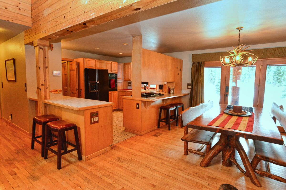 Large kitchen with counter seating.
