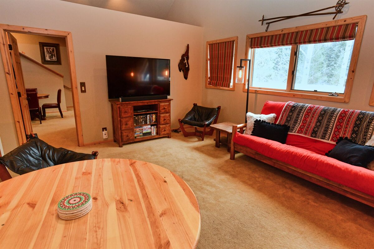 Second level loft with futon and big screen TV.