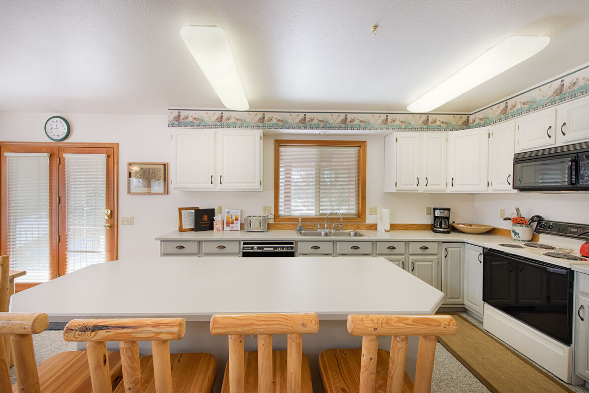 Well equipped kitchen has counter seating.