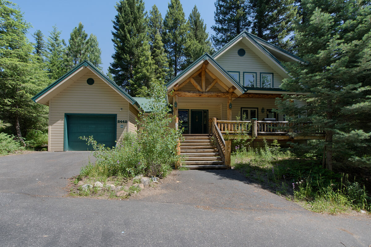 Lovely, 2nd tier lake cabin with garage and decks.