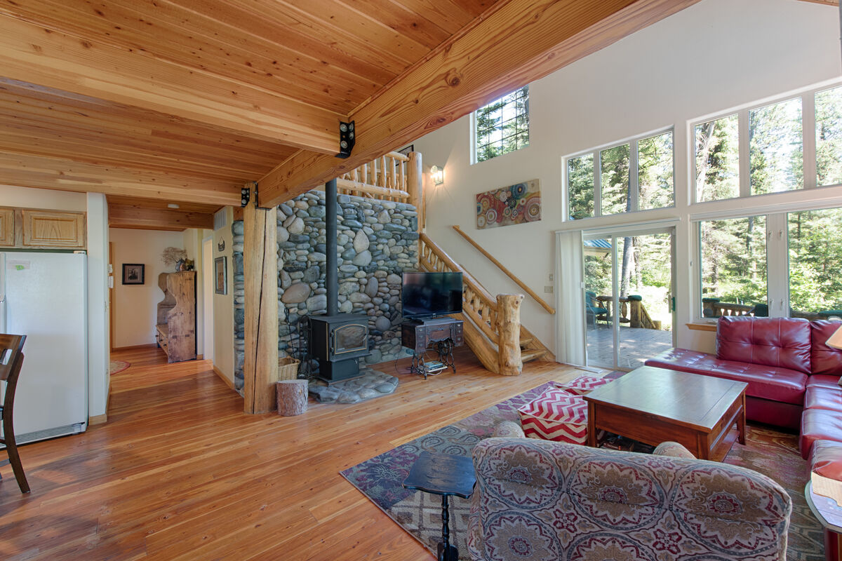 Living room has lovely forest views.