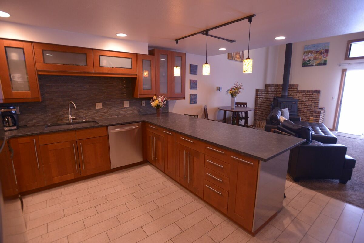 Kitchen and living area - well lit.