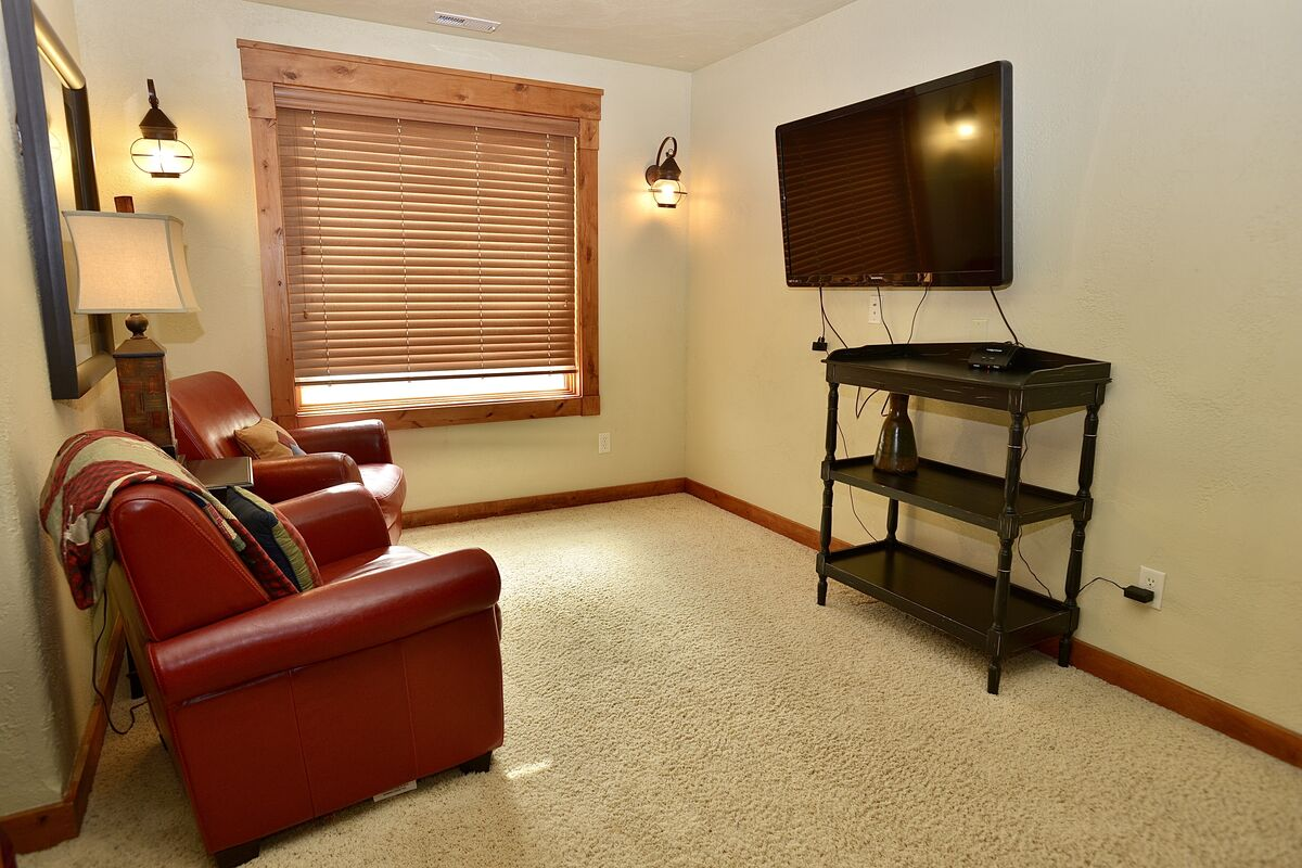 sitting area and TV in upstairs game room